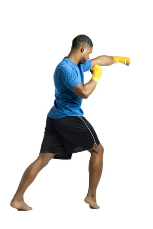 aieron: Rear view shot of an aggressive African boxer practicing over a white background Stock Photo