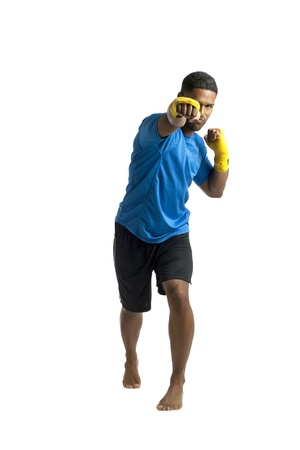 aieron: Portrait of black man punching while standing on a white background Stock Photo