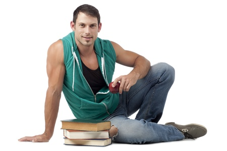 hooded vest: Portrait of smiling attractive guy sitting on the floor holding red apple with books