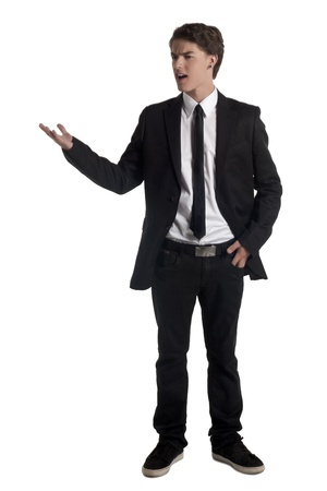 teenage guy: Portrait of attractive teenage guy in upset gesture against white background