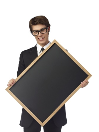 teenage guy: Bachelor teenage guy holding a slate board over the white background Stock Photo