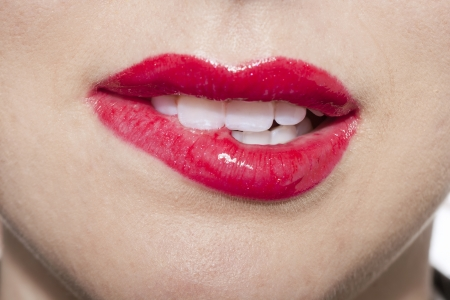 Close up image of woman biting her lips