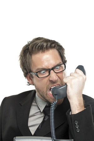 Close-up image of angry businessman shouting on the telephone isolated on a white background