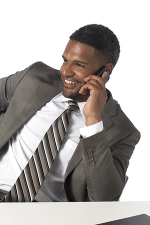 Close up portrait of a smiling businessman using his cellphone to make a call Stock Photo