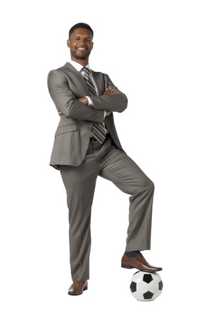 African american businessman stepping on a soccer ball photo