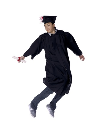 Portrait of a graduating man holding his diploma leaping on air photo