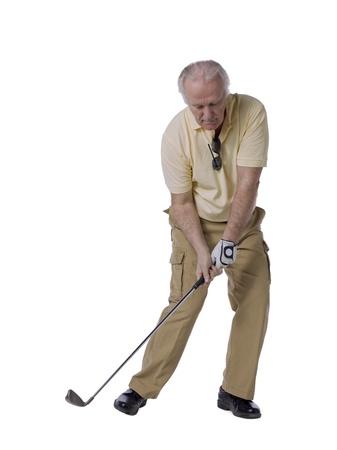 Handsome senior man playing golf photo