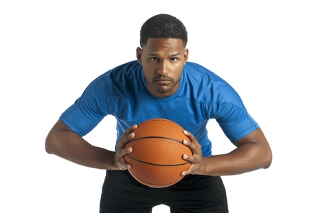 aieron: Portrait of black man about to pass the ball in a front view image