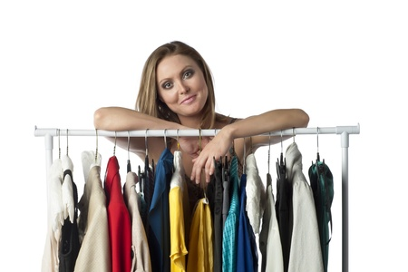 Portrait of beautiful woman with wardrobe collection Stock Photo
