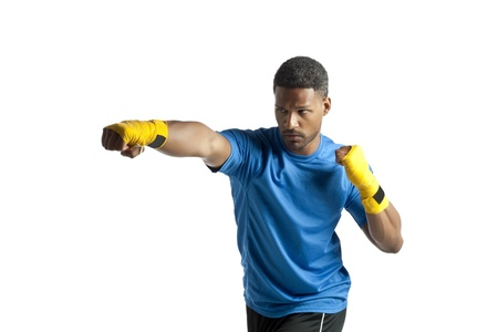 Portrait of black american guy in punching stance against white background Stock Photo - 17519624