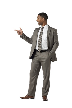 Black businessman pointing something at the side of white surface Stock Photo - 17520056
