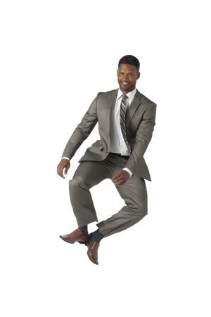aieron: Ritratto di uomo d'affari felice che salta su sfondo bianco