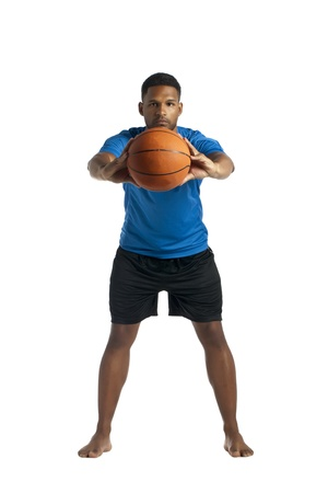 aieron: Portrait of black guy holding a basketball ball against white background