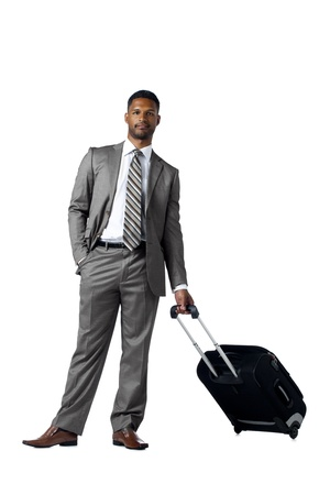 Portrait of black man holding a traveling luggage over the white surface