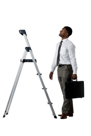 African american businessman looking on top of a steel ladder Stock Photo - 17519369
