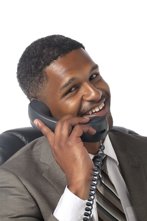 Portrait of a happy businessman talking on the telephone Stock Photo - 17521478