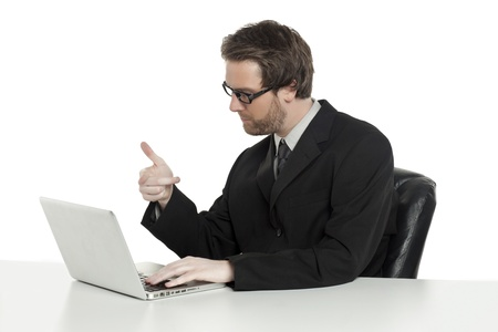 Portrait of businessman pointing to his laptop against white background Stock Photo - 17520308