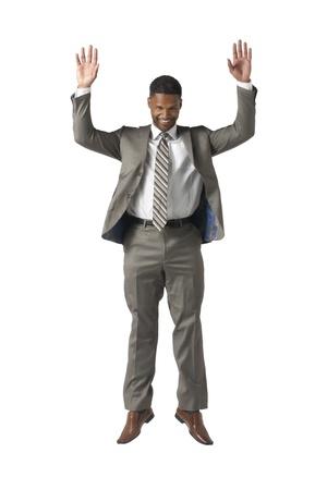 Joyful businessman raising his two hands Stock Photo - 17519882