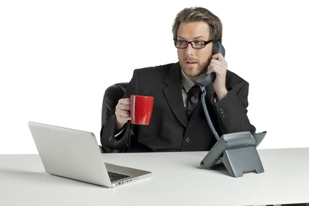 Calling businessman while holding a cup of hot coffee Stock Photo - 17520453