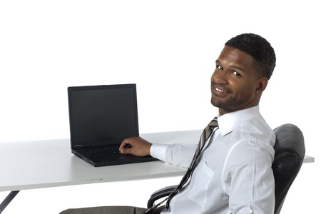 aieron: Portrait of smiling and confident black businessman with laptop against white background