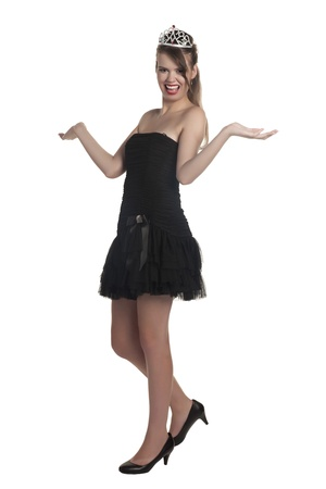 prom queen: Full length image of a crowned female in black dress posing over a white background Stock Photo