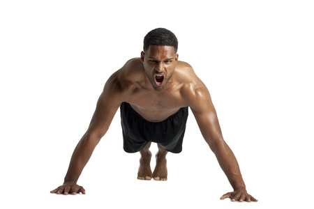 Close-up image of a dark man screaming while doing push up over the white surface photo