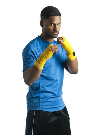 aieron: Portrait of dark man training boxing isolated on a white surface