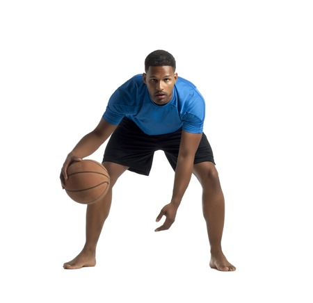 aieron: Facade shot of an african american man dibbling a basketball over a white background