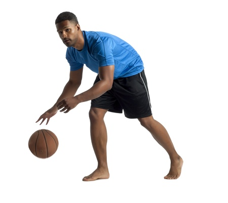 aieron: Portrait of young black man dribbling a basketball over a white background