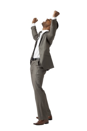 Side view image of excited businessman with arms raised Stock Photo - 17519876
