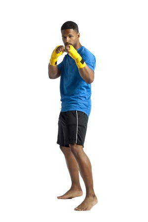 aieron: Portrait of dark fitness man on punching stance isolated on a white background