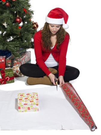 Portrait of girl sitting while starting to wrap a gift photo