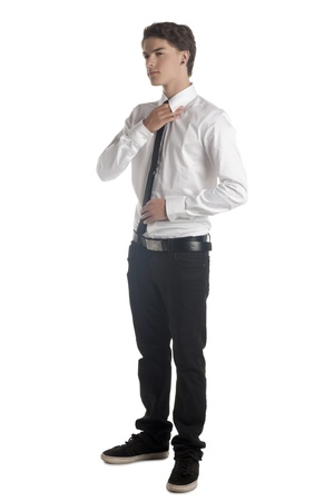 the sleeve: Portrait of a handsome male wearing long sleeve holding his tie over the white background