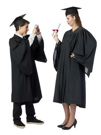 Close-up image of handsome male taking picture of her female classmate after the graduation ceremony Stock Photo - 17519877