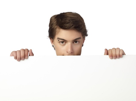 Close-up image of handsome man hiding on a white cardboard Stock Photo - 17519650