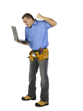 A happy man holding laptop isolated on white Stock Photo - 17520030
