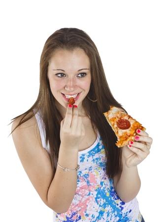 Happy teenage girl eating pizza over white background. Stock Photo - 17520908