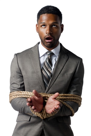 Isolated image of a helpless businessman tied with a rope Stock Photo - 17515991