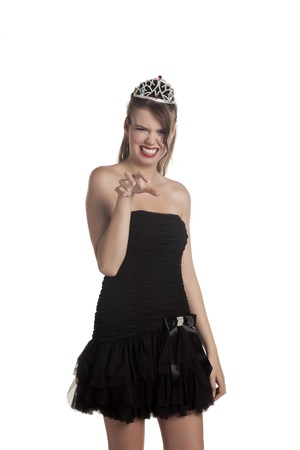 hot babe: Portrait of a hot babe in black dress wearing a crown Stock Photo