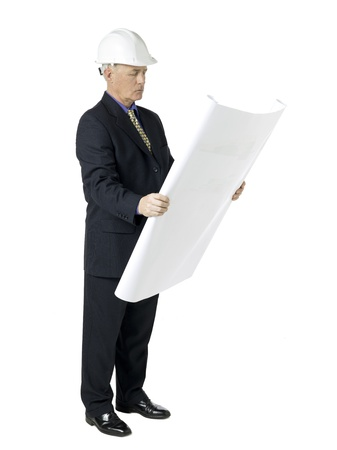 Side view image of an architecture wearing white hard hat and reading blueprint paper. Stock Photo - 17519602