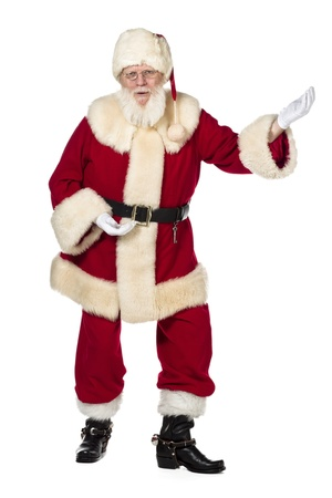 Portrait shot of Father Santa dancing against white background. photo