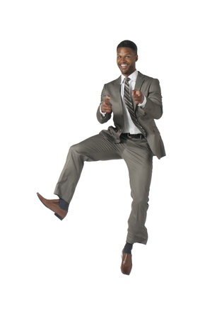 Portrait of an African american businessman jumping in joy Stock Photo - 17519322