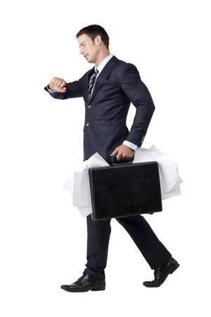 Late Businessman walking in a hurry while Glancing at His Watch Stock Photo - 17519628