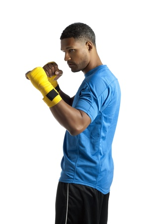 aieron: Portrait of male boxer on jab stance on a white background