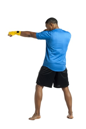 aieron: Rear view shot of practicing male boxer over a white background