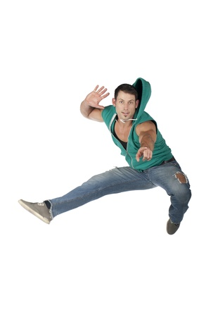 Portrait of a male dancer jumping over the white surface