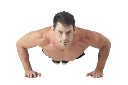 Facade shot of a man doing push up exercise photo