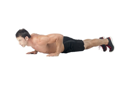 Side view shot of a man doing push up photo