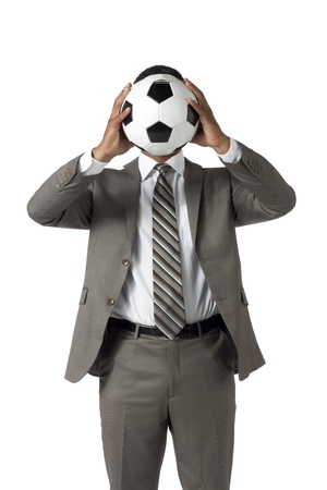 Man in suit covering his face using a soccerball Stock Photo - 17521328