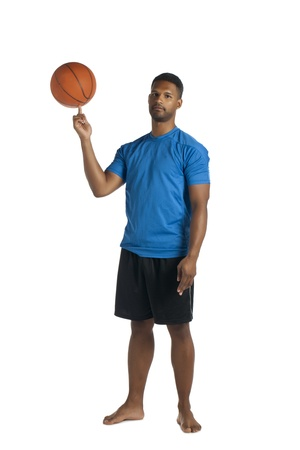aieron: Mid adult man spinning basketball in air photo